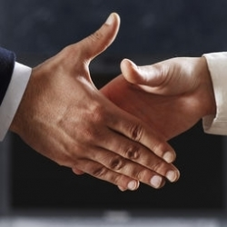 With a handshake