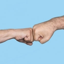 With a fist bump