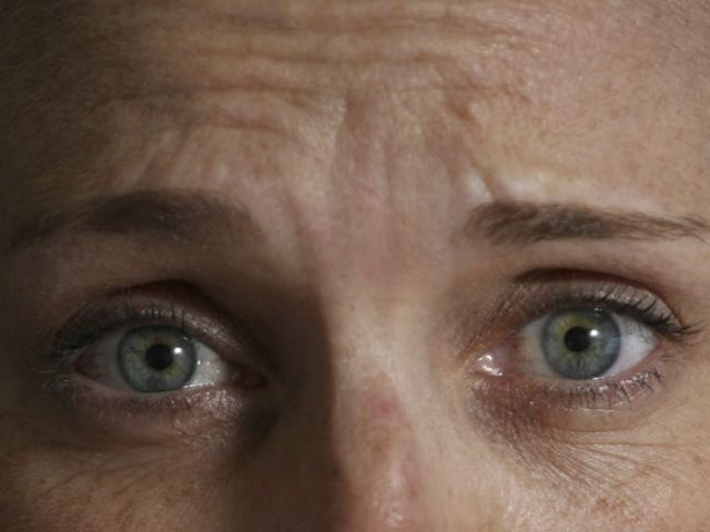 Look at this woman's eyes. What is the dominant emotion?